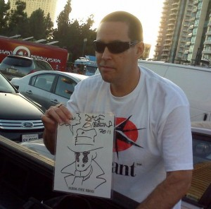 Elveen with a Dave Gibbons charity sketch for Cystic Fibrosis